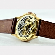 05877 chronograph_universal_tricompax_gold_1950_g