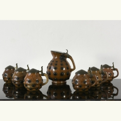 BEER JUG WITH 6 CAPPED STEINS - PAUL WYNAND - MERKELBACH - 1908